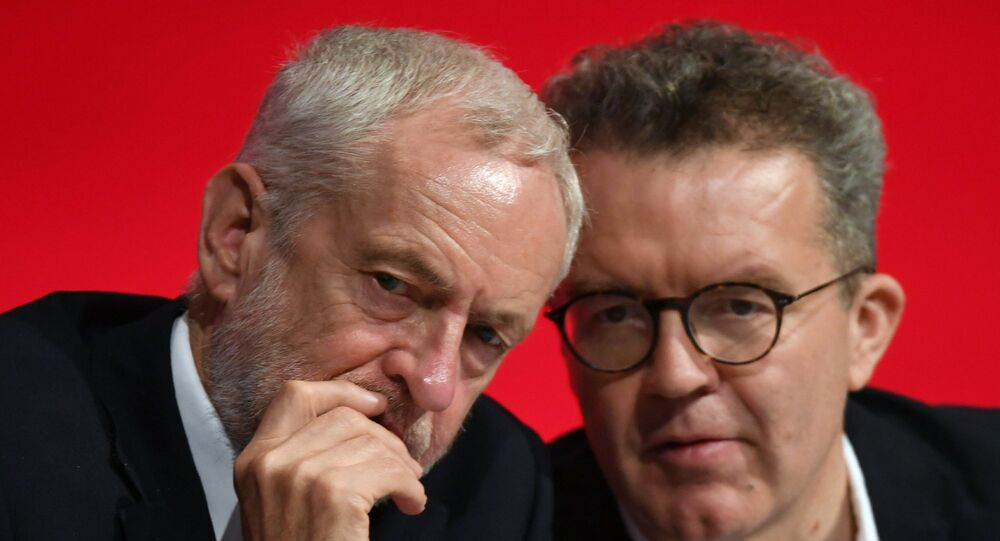 Britain's opposition Labour Party leader Jeremy Corbyn, left, talks with deputy leader Tom Watson during the start of the party's annual conference in Liverpool, England