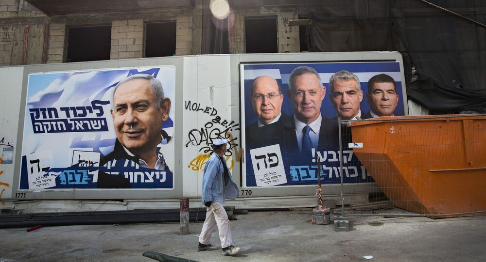 A man walks by election campaign billboards showing Israeli Prime Minister and head of the Likud party Benjamin Netanyahu, left, alongside the Blue and White party leaders, from left to right, Moshe Yaalon, Benny Gantz, Yair Lapid and Gabi Ashkenazi, in Tel Aviv, 7 Sunday 2019. Hebrew-language billboards read Strong Likud strong Israel (left) and  Every vote matters, win Blue and White (right). (AP Photo/Oded Balilty)