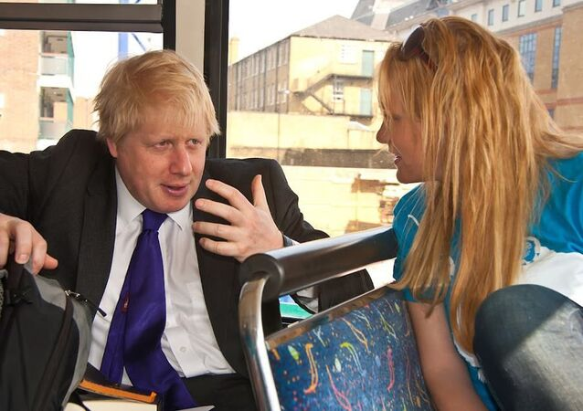 Boris Johnson and Jennifer Arcuri speak on a campaign bus in 2012.