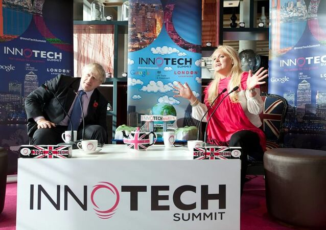 Boris Johnson, then-Mayor of London, speaks with Jennifer Arcuri at an event organised by her company, Innotech, in London on 30 October 2013.