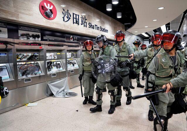 Police officers walk at Sha Tin Station in Hong Kong, China September 22, 2019.