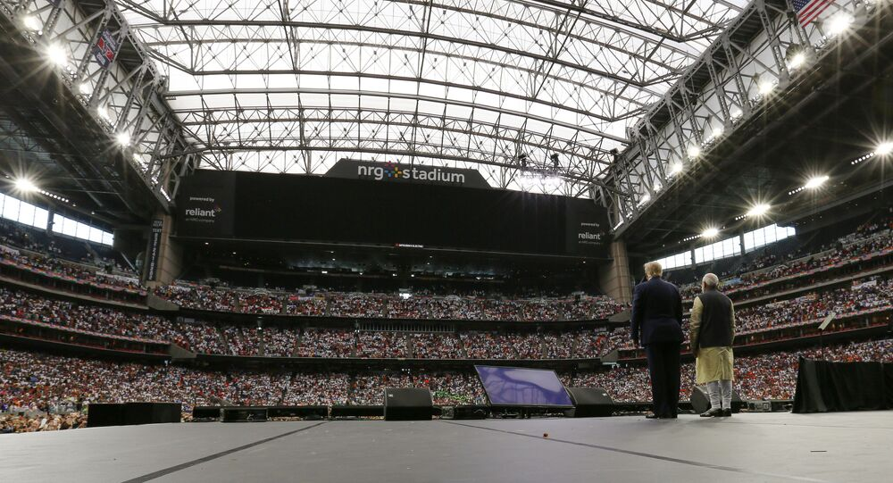 """US President Donald Trump participates in the """"Howdy Modi"""" event with India's Prime Minister Narendra Modi at a football stadium in Houston, Texas, 22 September 20192019"""