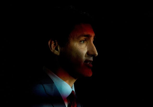 Flickering lights shine as Canada's Prime Minister Justin Trudeau speaks during an election campaign stop in Toronto, Ontario, Canada September 20, 2019