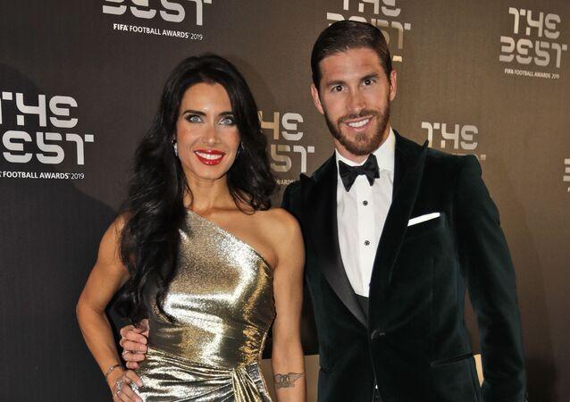 Real Madrid's Sergio Ramos arrives with his partner Pilar Rubio