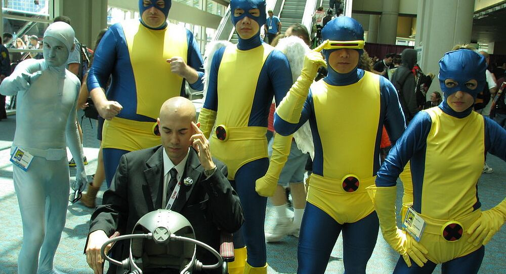 A group cosplay of the original X-Men. From the top row and left to right is Iceman, Beast, Angel, Cyclops, and Jean Grey [Marvel Girl]. In the front row is Prof. Xavier