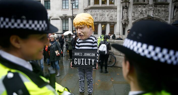A protester stands outside the Supreme Court of the United Kingdom after the hearing on British Prime Minister Boris Johnson's decision to prorogue parliament ahead of Brexit, in London, Britain September 24, 2019