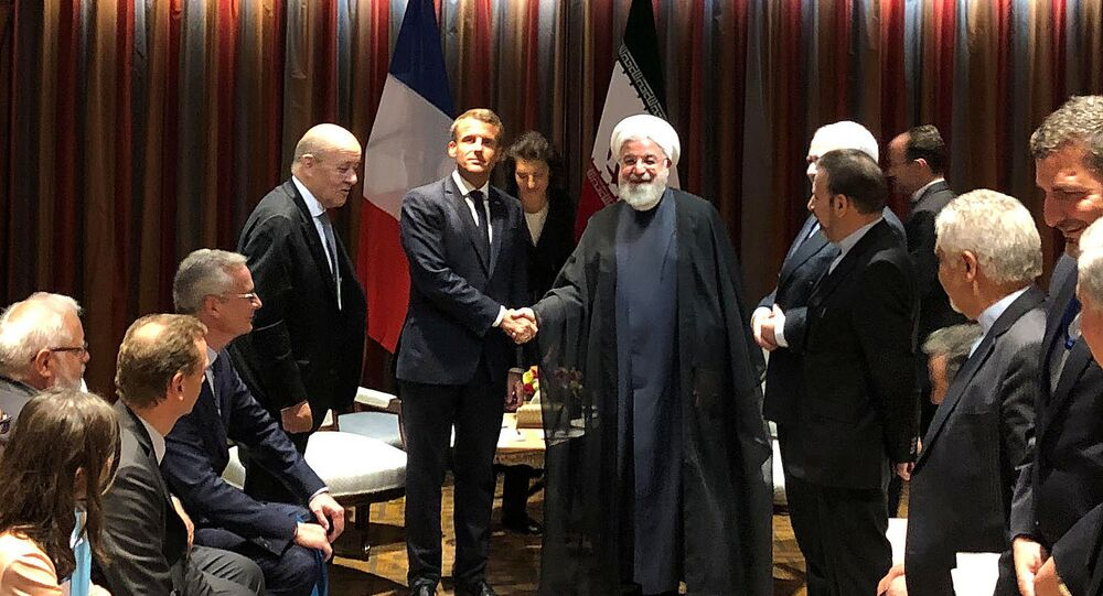 French President Emmanuel Macron shakes hands with Iranian President Hassan Rouhani during their meeting on the sidelines of the United Nations General Assembly in New York, U.S., September 23, 2019