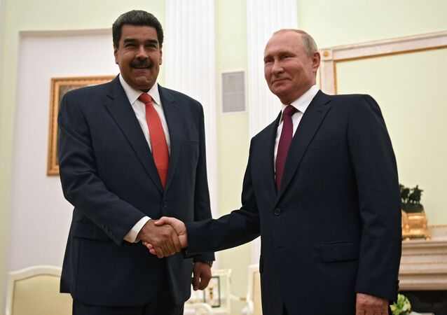 Russian President Vladimir Putin shakes hands with Venezuelan President Nicolas Maduro during a meeting at the Kremlin in Moscow, Russia September 25, 2019