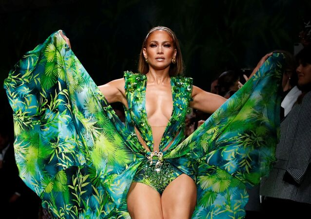 Jennifer Lopez presents a creation from the Versace Spring/Summer 2020 collection during fashion week in Milan, Italy September 20, 2019