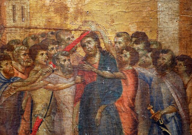 A part of the painting Christ Mocked, a long-lost masterpiece by Florentine Renaissance artist Cimabue in the late 13th century, which was found months ago hanging in an elderly woman's kitchen in the town of Compiegne, is seen in Paris, France, September 24, 2019.    REUTERS/Charles Platiau