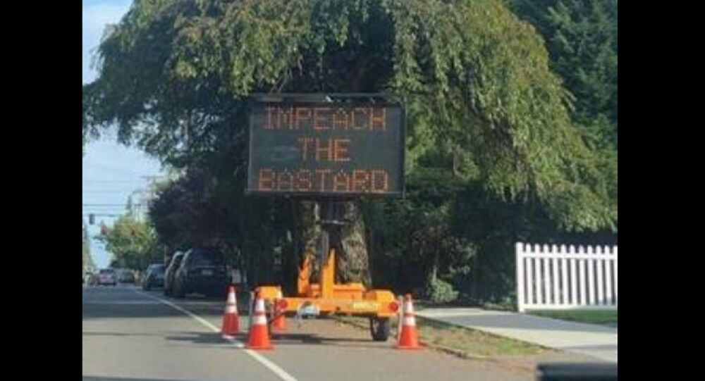 Hacked Seattle road sign says 'Impeach the Bastard'