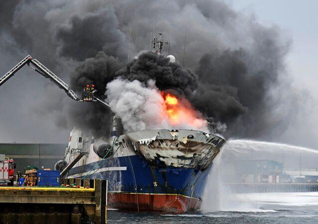 The Russian fishing trawler Bukhta Naezdnik burns in the harbour of Tromso, Norway September 25, 2019. Picture taken September 2019