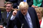Britain's Prime Minister Boris Johnson gestures as he speaks at the parliament, which reconvenes after the UK Supreme Court ruled that his suspension of the parliament was unlawful, in London, Britain, September 25, 2019, in this screen grab taken from video