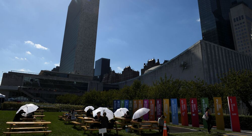 Attendees of the United Nations General Assembly use white umbrellas for shade at the United Nations in New York City, New York, U.S., September 25, 2019