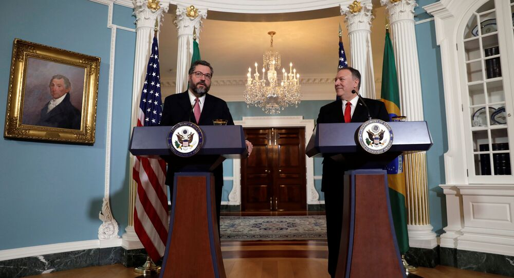 U.S. Secretary of State Mike Pompeo (R) and Brazilian Foreign Minister Ernesto Araujo hold a joint news conference after their meeting at the State Department in Washington, U.S., September 13, 2019
