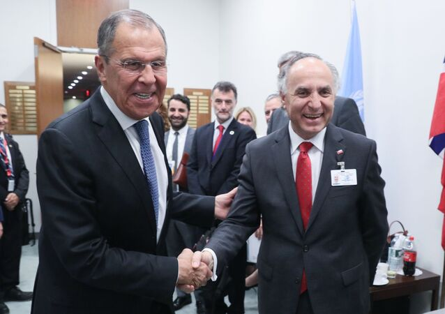 Russian Foreign Minister Sergey Lavrov and Chile's Foreign Minister Teodoro Ribera shake hands prior to a meeting on the sidelines of the 74th session of the UN General Assembly at the headquarters of the United Nations in Manhattan, New York, United States
