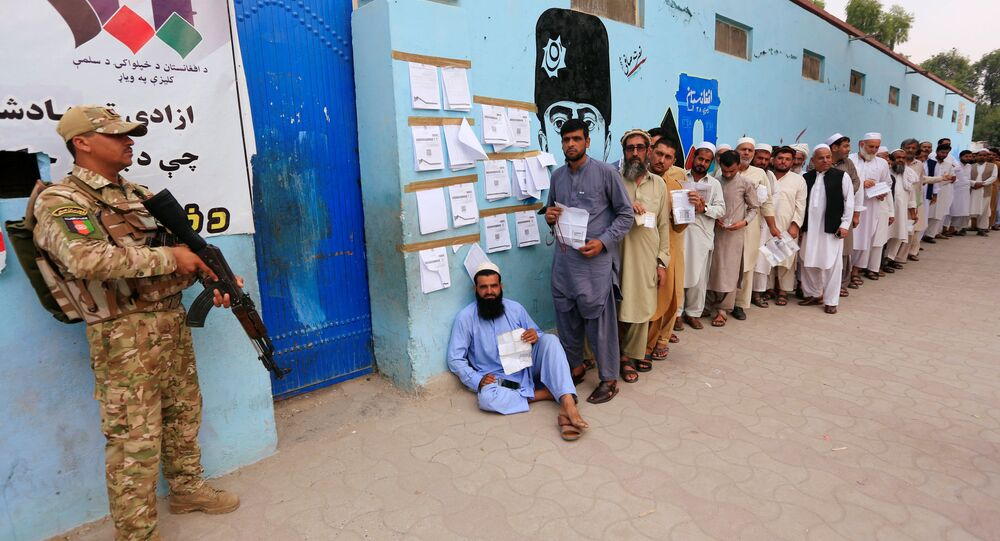 Men arrive to cast their votes outside a polling station in the presidential election in Jalalabad, Afghanistan 28 September 2019.