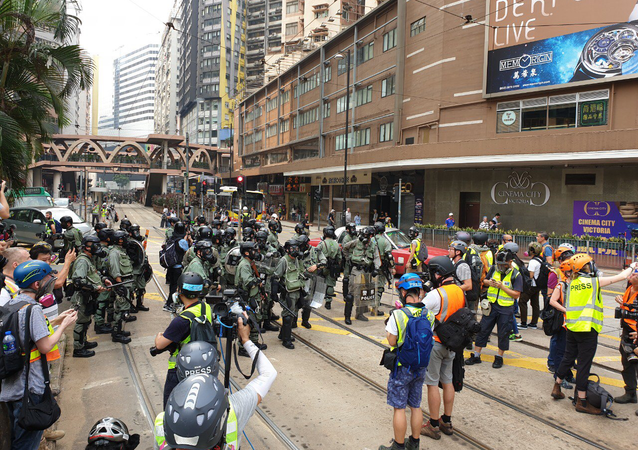 Police officers prepare for protests in Hong Kong