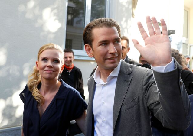 Top candidate of Peoples Party (OeVP) and former Chancellor Sebastian Kurz leaves with his girlfriend Susanne Thier after casting his ballot at a polling station in Vienna, Austria September 29, 2019.