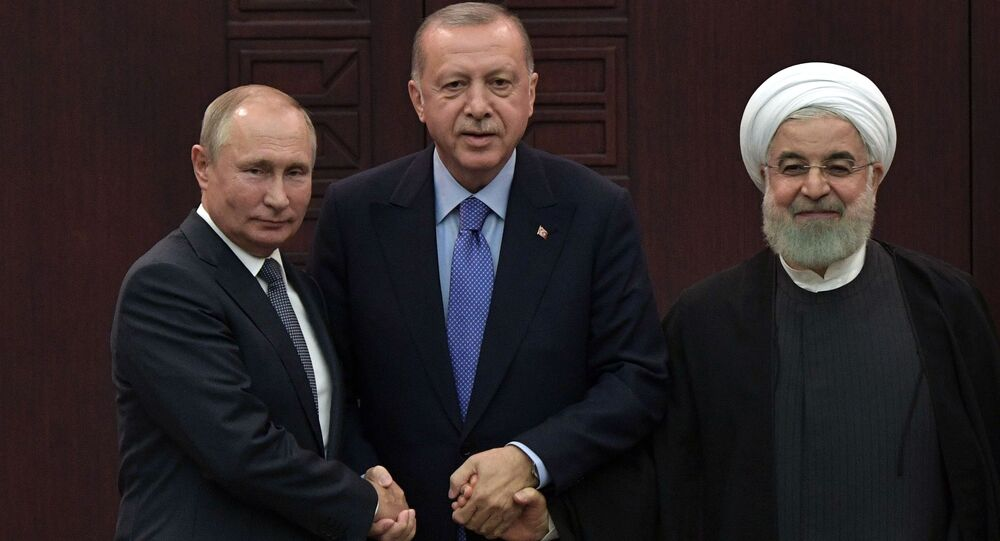 President of Russia Vladimir Putin, Turkish President Recep TayyipErdogan and Iranian President Hassan Rouhani during a joint press conference after the 5th Trilateral Summit in Astana format on the Syrian crisis