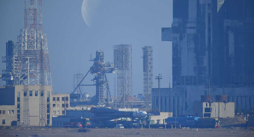 Russia's Soyuz-FG rocket booster carrying the Soyuz MS-15 spacecraft is transported from an assembling hangar to the launchpad ahead of its upcoming launch, at the Baikonur Cosmodrome, in Kazakhstan.