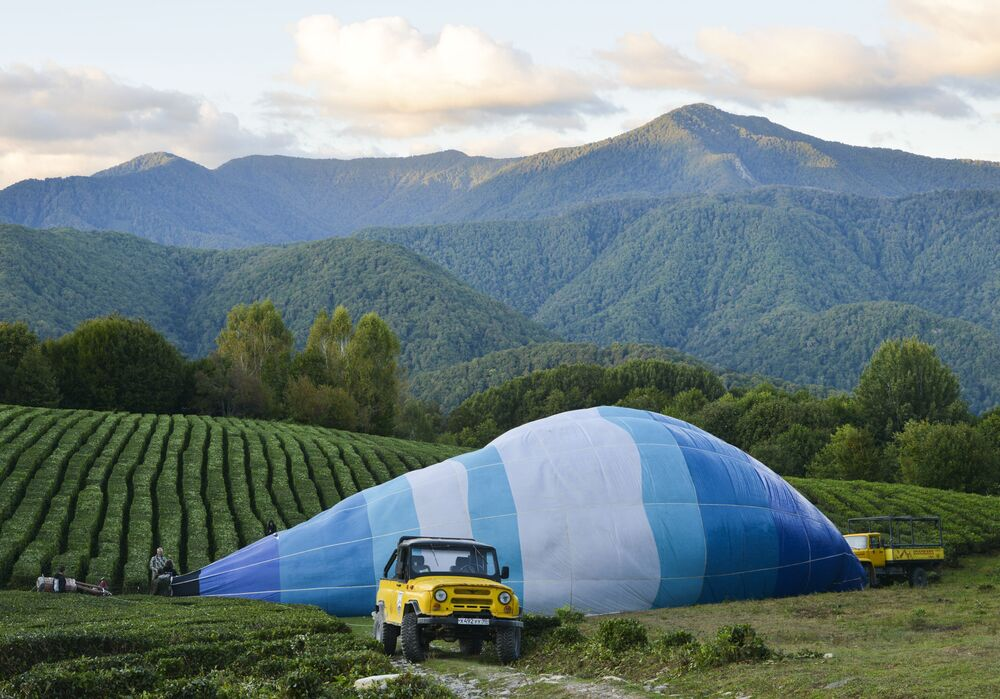 Balloonists prepare hot air balloons for flight during the Sochi Balloon Festival, in Sochi, Russia.