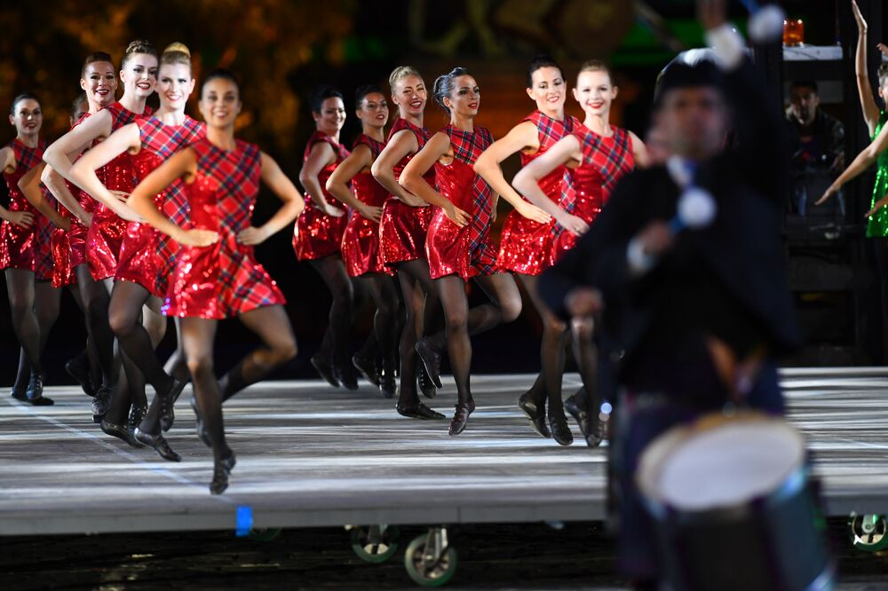 The International Celtic Dance Team performs during the closing ceremony of the Spasskaya Tower festival on Red Square in Moscow.