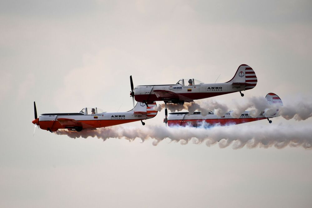 Yakovlev Yak-50 aircraft of the ANBO aerobatic team from Lithuania perform during a demonstration flight at the MAKS-2019 International Aviation and Space Show in Zhukovsky, outside Moscow, Russia.