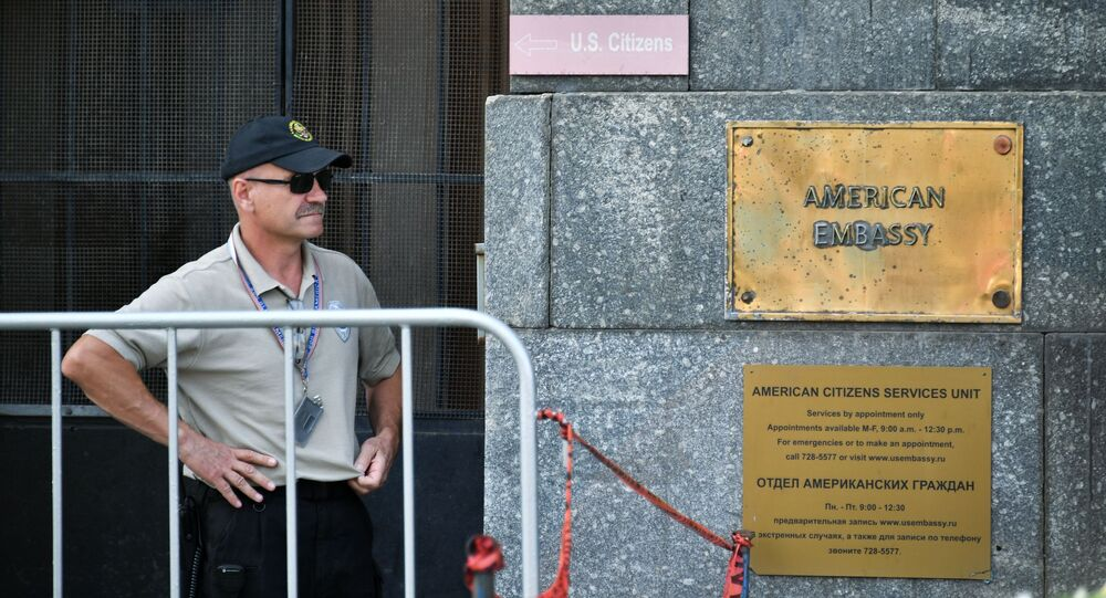 A sign on the United States Embassy in Moscow. Starting August 23, the US will suspend issuing nonimmigrant visas in Russia