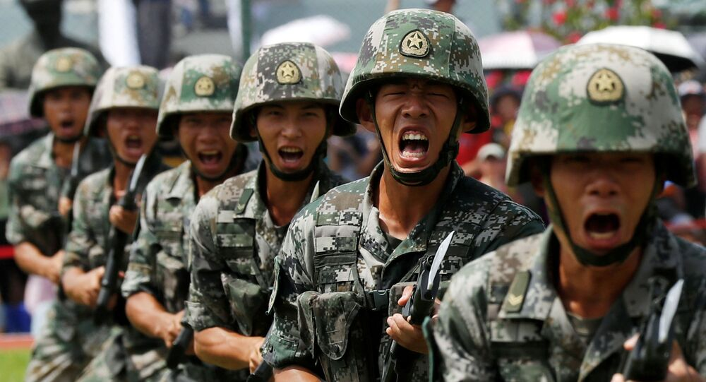 People's Liberation Army (PLA) soldiers take part in a performance during an open day at Stonecutters Island naval base in Hong Kong