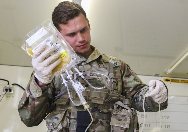 Pfc. Jaritt Louthan, a medical lab technician with 432nd Blood Support Detachment, 28th Combat Support Hospital, 44th Medical Brigade, and a native of Cleveland, re-hydrates freeze dried plasma during an airdrop test Sept. 19, 2019 at Fort Bragg, N.C. Jaritt is among the first few Soldiers to test the durability of the plasma packaging by parachuting to collect data for possible future use on the battlefield