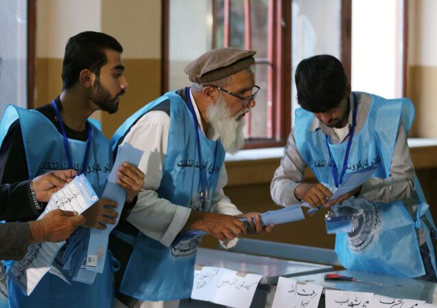 Afghan election commission workers count ballot papers of the presidential election in Kabul, Afghanistan September 28, 2019