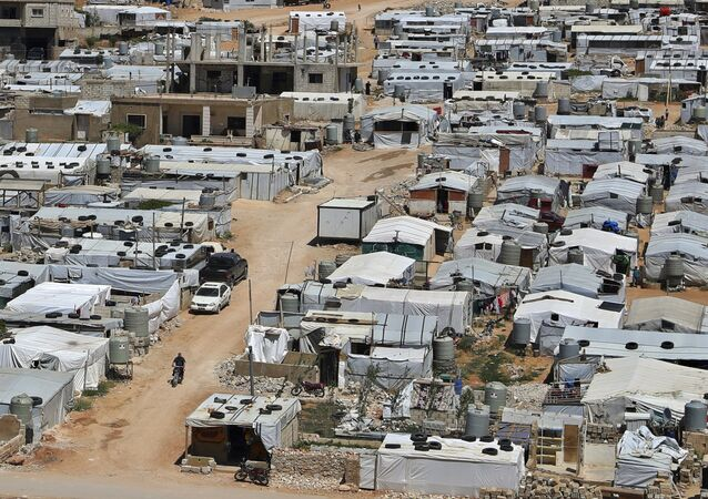 This June 16, 2019, file photo, shows a Syrian refugee camp in the eastern Lebanese border town of Arsal