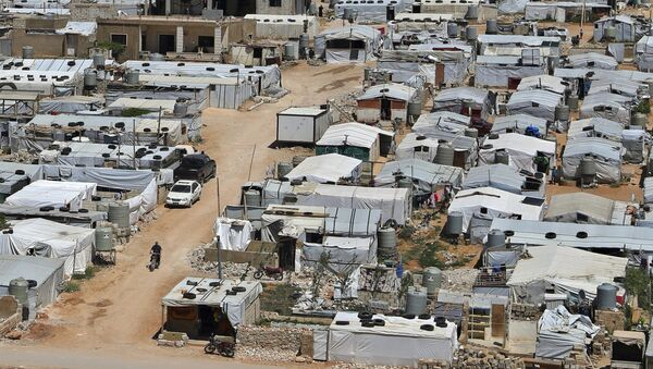 This June 16, 2019, file photo, shows a Syrian refugee camp in the eastern Lebanese border town of Arsal - Sputnik International