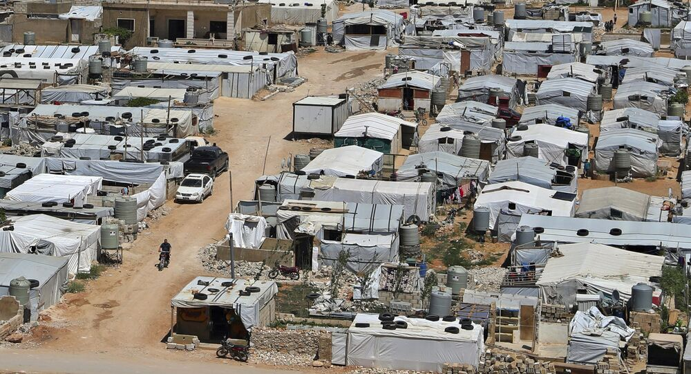 This 16 June 2019 file photo shows a Syrian refugee camp in the eastern Lebanese border town of Arsal