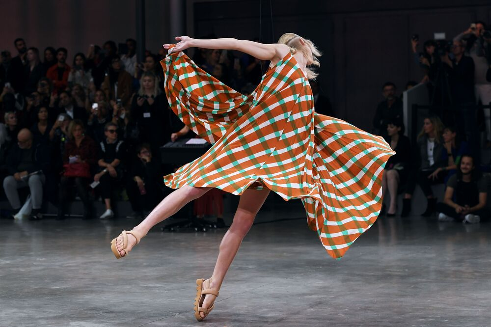 A model floats and dances as she presents a creation by Japanese designer Issey Miyake during the Women's Spring-Summer 2020 Ready-to-Wear collection fashion show, in Paris on September 27, 2019.