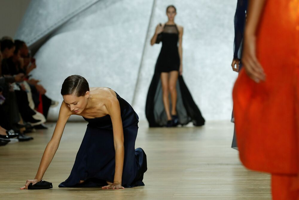 A model stumbles as she presents a creation by Swiss designer Albert Kriemler as part of his Spring/Summer 2020 women's ready-to-wear collection show for fashion house Akris during the Paris Fashion Week in Paris, France, September 29, 2019.