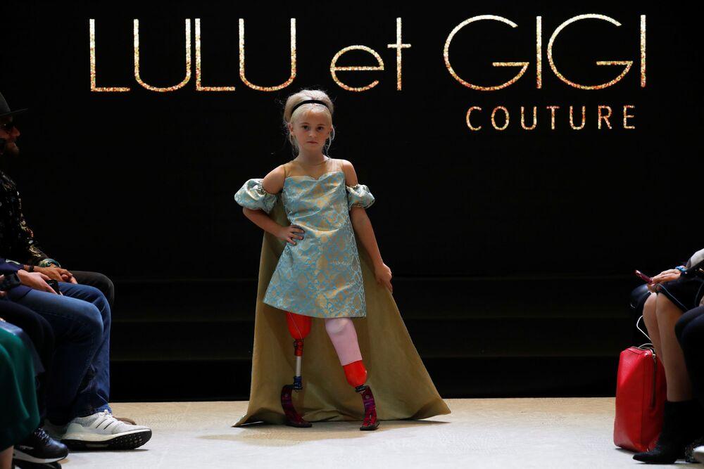 Model Daisy-May Demetre presents a creation by Designer Eni Hegedus-Buiron for luxury children's wear label Lulu et Gigi during Paris Fashion Week in Paris, France, September 27, 2019.