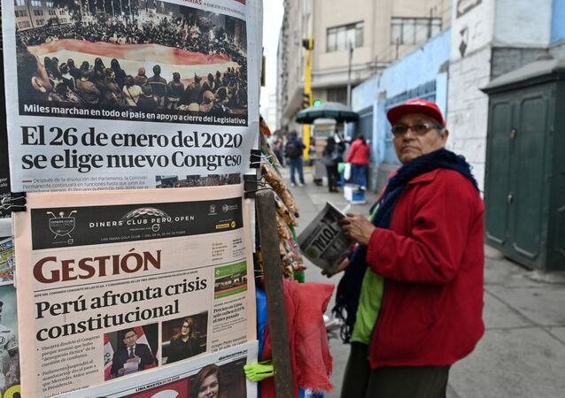 A man stands at a kiosk displaying front pages of newspapers in Lima on October 1, 2019, a day after Presiden Martin Vizcarra dissolved the unicameral Congress.