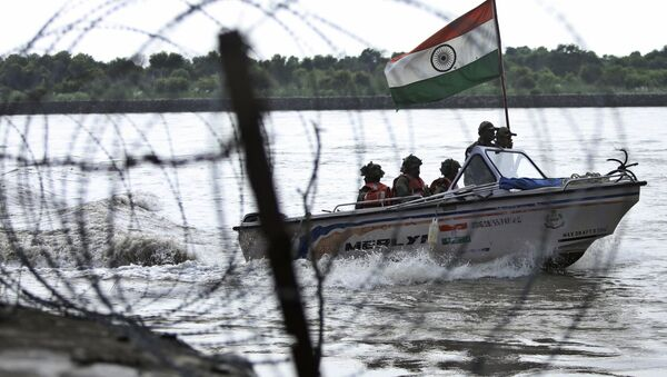 In this Tuesday, Aug. 13, 2019 file photo, Indian Border Security Force (BSF) soldiers patrol on a boat in river Chenab at Pargwal area along the India-Pakistan border in Akhnoor, about 55 kilometers (34 miles) west of Jammu, India - Sputnik International