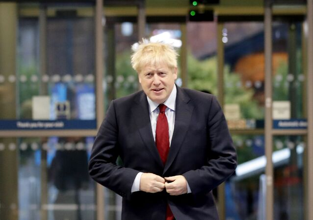 Britain's Prime Minister Boris Johnson arrives at the Conservative Party Conference in Manchester