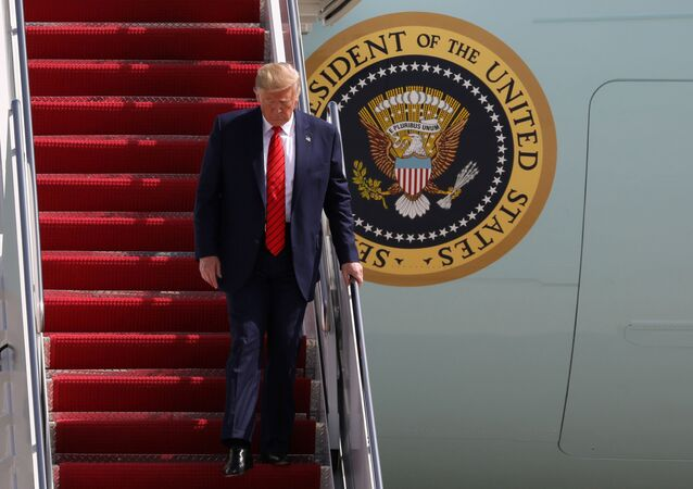 US President Donald Trump arrives aboard Air Force One at Joint Base Andrews, Maryland, 26 September 2019