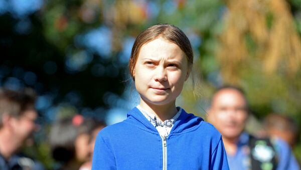 Climate change teen activist Greta Thunberg looks on before joining a climate strike march in Montreal, Quebec, Canada September 27, 2019 - Sputnik International