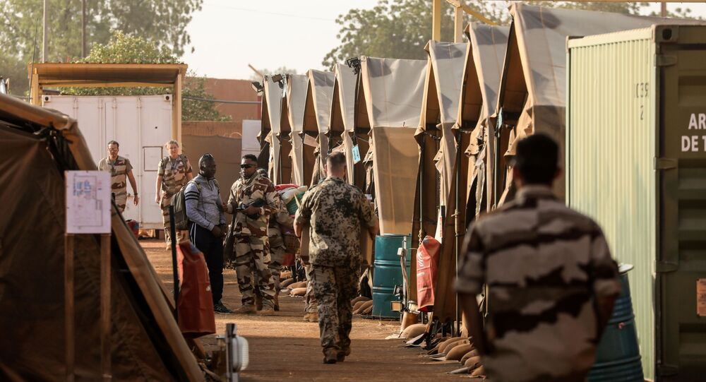 Soldiers of France's Barkhane mission walk in the military camp set up in a part of the airport base on December 22, 2017, in Niamey