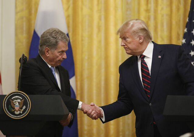 President Donald Trump shakes hands with Finnish President Sauli Niinisto, as they participate in a news conference at the White House in Washington, Wednesday, Oct. 2, 2019
