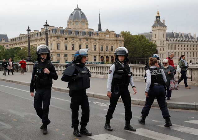 French police secure  the area in front of the Paris Police headquarters in Paris , France, October 3, 2019