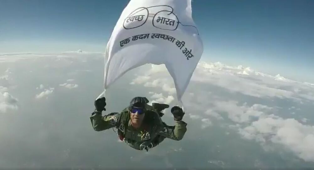Difficult to beat that - Wing Commander Gajanand Yadava in a skydive jump with the Swachh Bharat Abhiyan flag from a C-130J at 15,000 feet