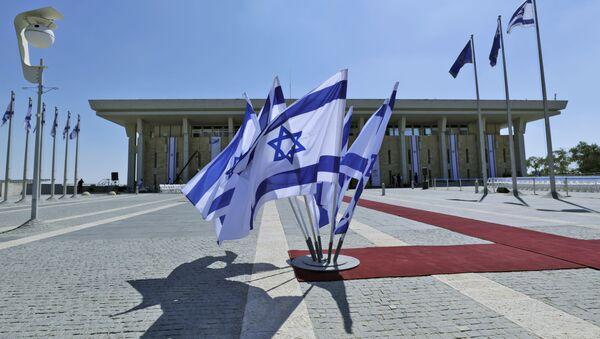 This picture taken on October 3, 2019 shows Israeli flags flying outside the Knesset (Israeli parliament) headquarters in Jerusalem - Sputnik International