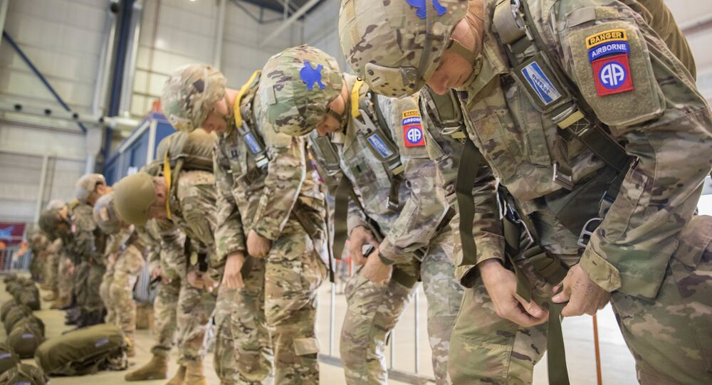 A group of U.S. Army and International Paratroopers rig into their parachutes and prepare to jump into Groesbeck Drop Zone during the 75th Anniversary of Market Garden on Einhoven Air Field, Einhoven, Netherlands., September 19, 2019