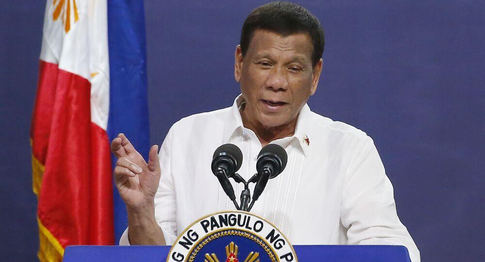 FILE - In this Aug. 27, 2019, file photo, Philippine President Rodrigo Duterte gestures as he addresses the topic of land reform in Manila, Philippines